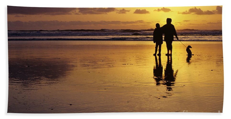 Pacific Northwest Hand Towel featuring the photograph Family On Beach With Dog Sunset by Jim Corwin