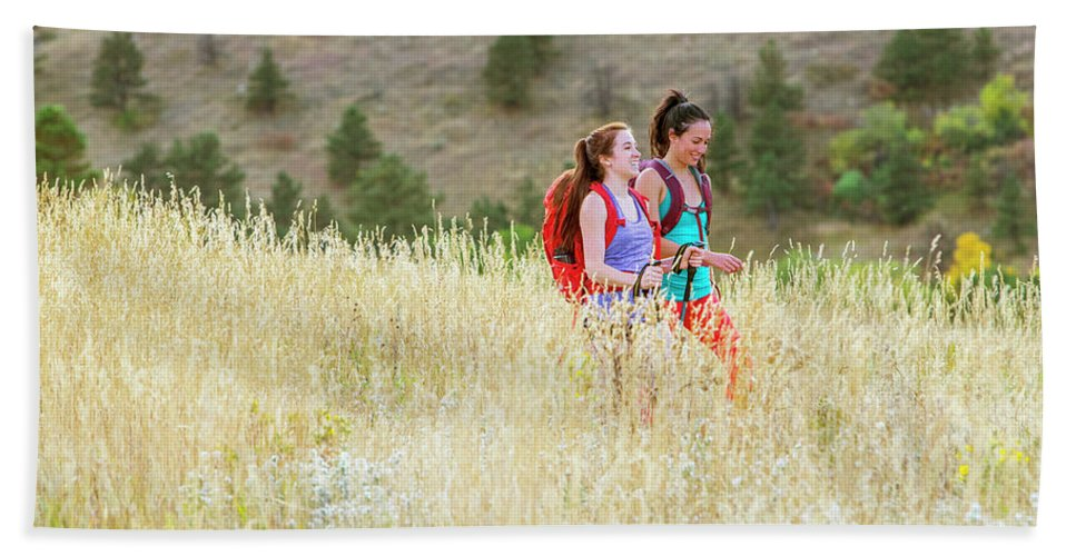 Day Bath Sheet featuring the photograph Female Hikers Walk On A Trail by Alexandra Simone