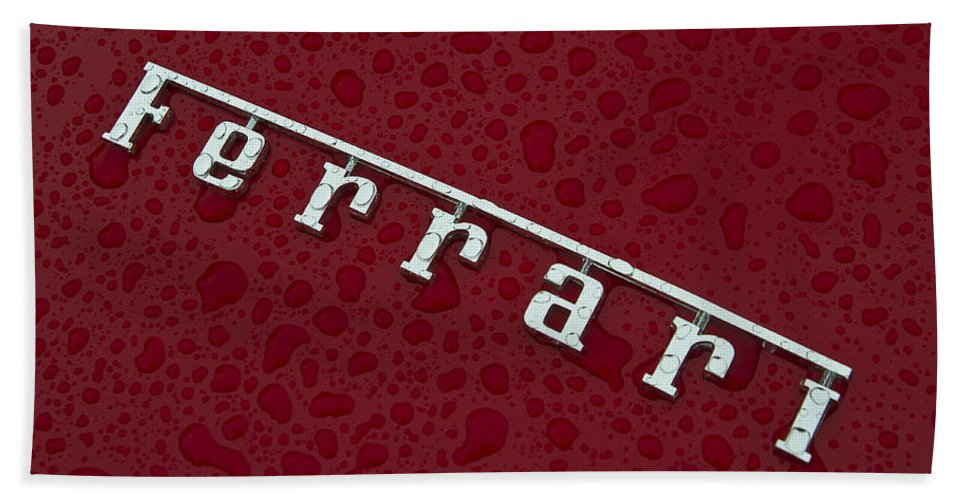 Ferrari Hand Towel featuring the photograph Ferrari Emblem In The Rain by Joel Witmeyer