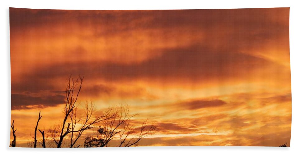 Orange Sunset Hand Towel featuring the photograph Firey Sunset by Robert Brown