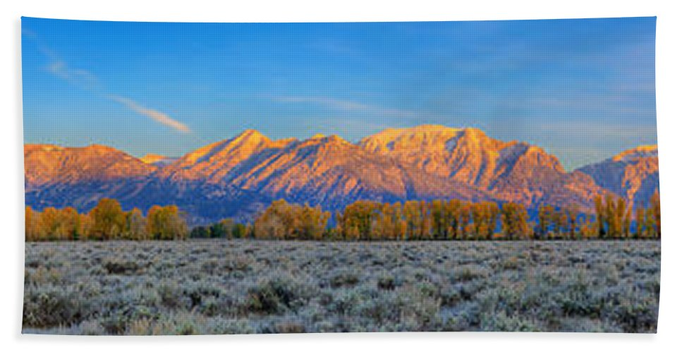 Tetons Bath Sheet featuring the photograph First Light On The Tetons Limited Edition Panorama by Greg Norrell