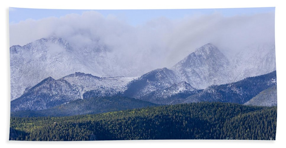 Pikes Peak Hand Towel featuring the photograph First Snow by Steve Krull