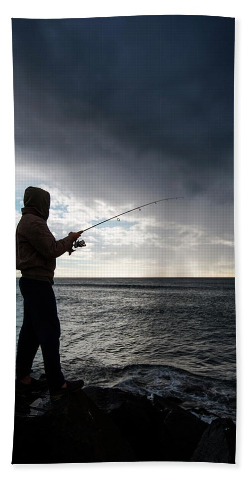 California Hand Towel featuring the photograph Fisherman Fishing While Storm Blows by Sam Wells
