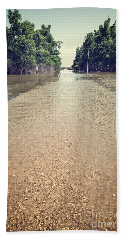 Acts Of God Bath Sheet featuring the photograph Flooded Road by Leslie Banks