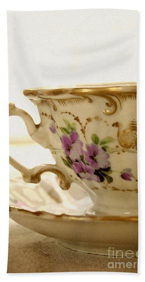 White; Beautiful; Gorgeous; Elegant; Shiny; Elegance; Teacup; High Tea; China; Porcelain; Floral Design; Prim; Proper; Dainty; Vintage; Antique; Saucer; Tea; Table; Bright; Close Up; Ornate; Gold; Floral Pattern; Pink; Purple Hand Towel featuring the photograph Floral Tea by Margie Hurwich
