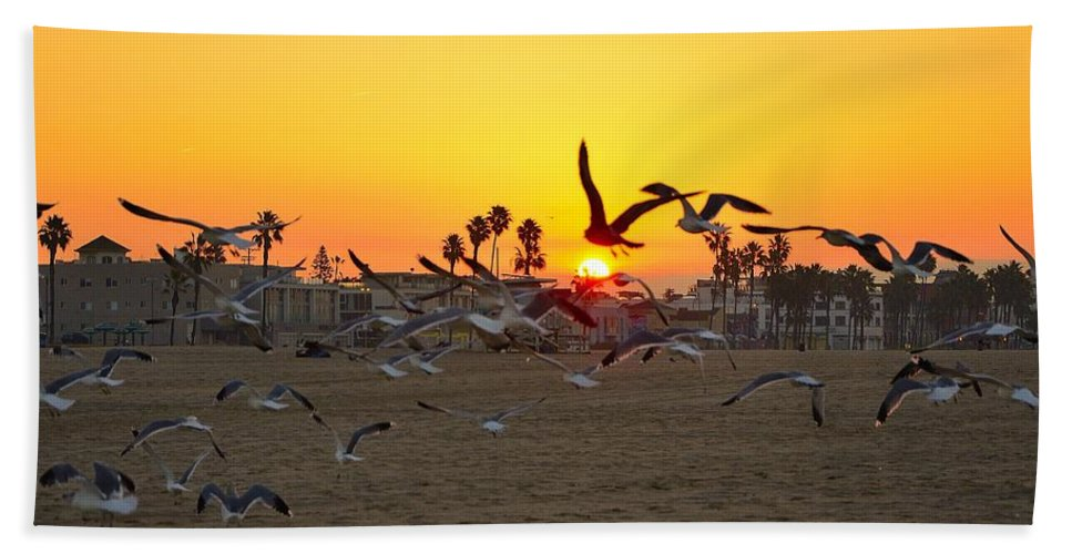Seagulls Bath Sheet featuring the photograph Flying To The Rising Sun by Yinguo Huang