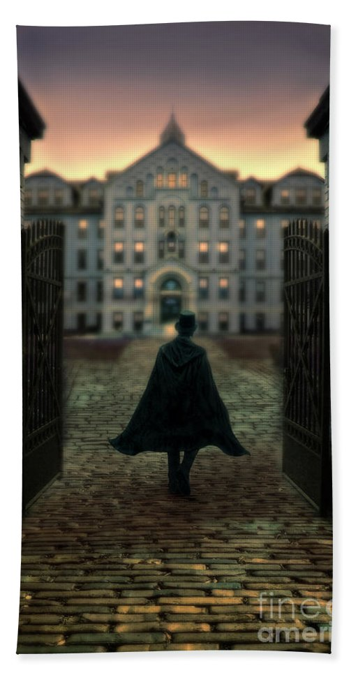 Man Hand Towel featuring the photograph Gentleman In Top Hat And Cape Walking Through Gates by Jill Battaglia
