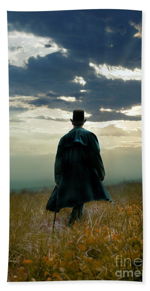 Man Bath Sheet featuring the photograph Gentleman In Top Hat Walking In Field by Jill Battaglia