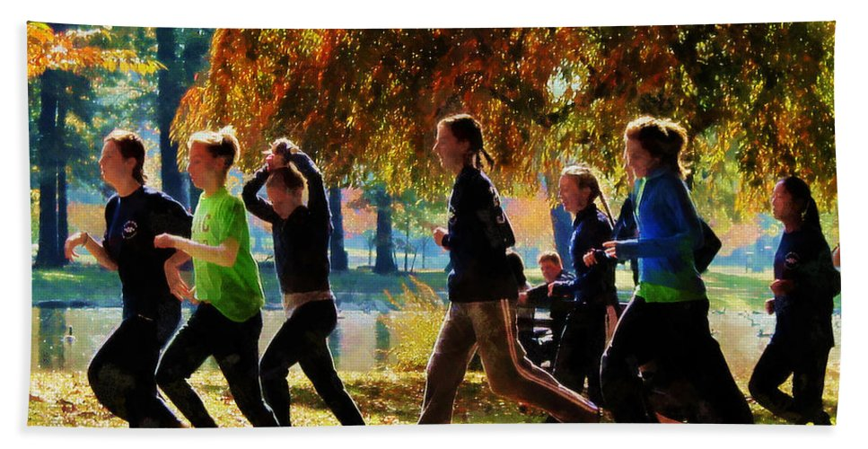 Jogging Bath Sheet featuring the photograph Girls Jogging On An Autumn Day by Susan Savad