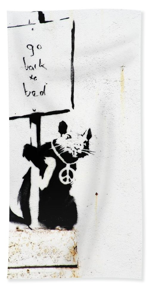 Banksy Hand Towel featuring the photograph Go Back To Bed Protester by A Rey