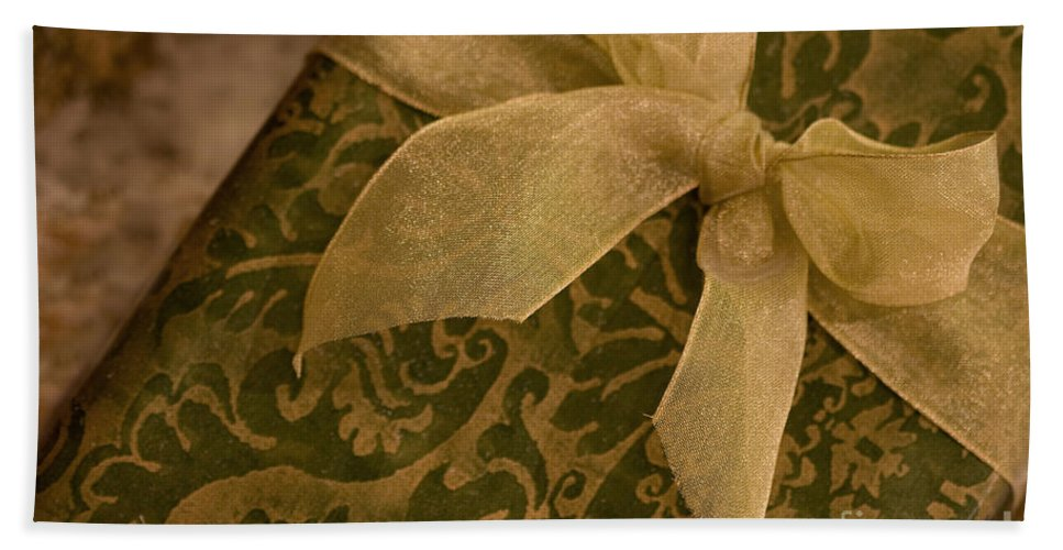 Present; Bow; Ribbon; Vintage; Gold; Green; Christmas; Decoration; Box; Xmas; Gift; Close Up; Celebration; Elegant; Festive; Holiday; Seasonal; Wrapped; Wrapping; Birthday Bath Towel featuring the photograph Golden Present by Margie Hurwich