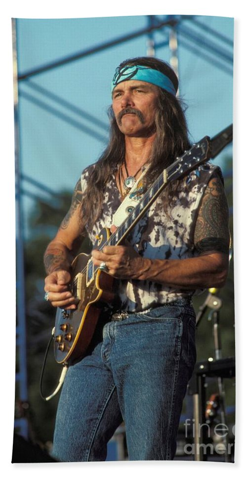 Dickey Betts Hand Towel featuring the photograph Guitarist Dickie Betts by Concert Photos