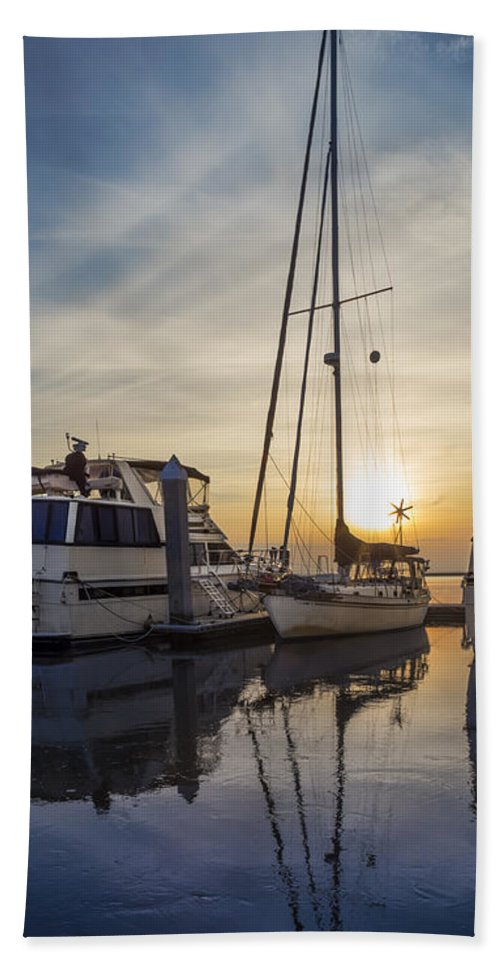 Boats Hand Towel featuring the photograph Harbor Light by Debra and Dave Vanderlaan