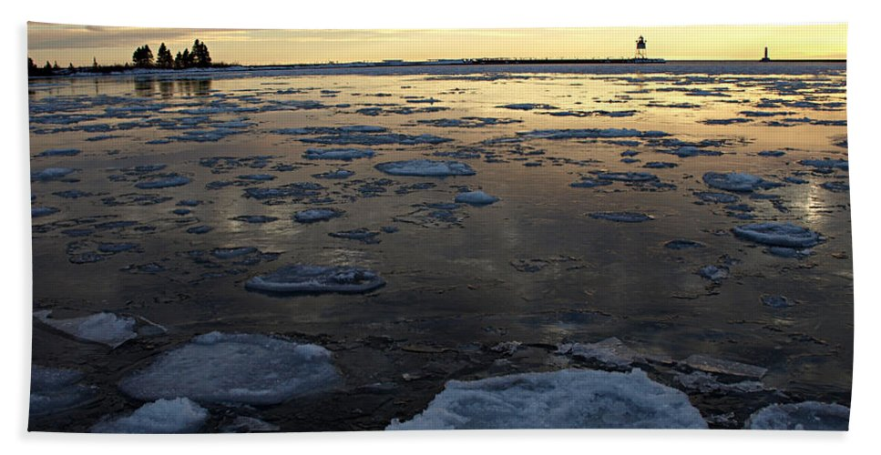 Peterson Nature Photo Photography Ice Pancake Pancakes Donut Doughnut Donuts Doughnuts Sunset Sunsets Reflection Reflections Reflecting Icy Frozen Cold Winter Wintertime Lighthouse Lighthouses Light House Houses Lake Superior Great Lakes North Shore Harbor Harbors Grand Marias Formation Formations Silhouette Silhouettes Cloud Clouds Dusk Landscape Landscapes Seascapes Seascape Water Freshwater Minnesota Mn Natural Marine Port Ports Serene Scenic America Midwest Beautiful Amazing Weather Extreme Hand Towel featuring the photograph Harbor Sunset by James Peterson