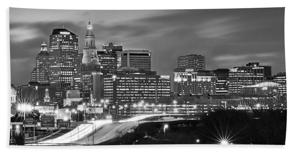 Hartford Skyline At Night Hand Towel featuring the photograph Hartford Skyline At Night Bw Black And White Panoramic by Jon Holiday