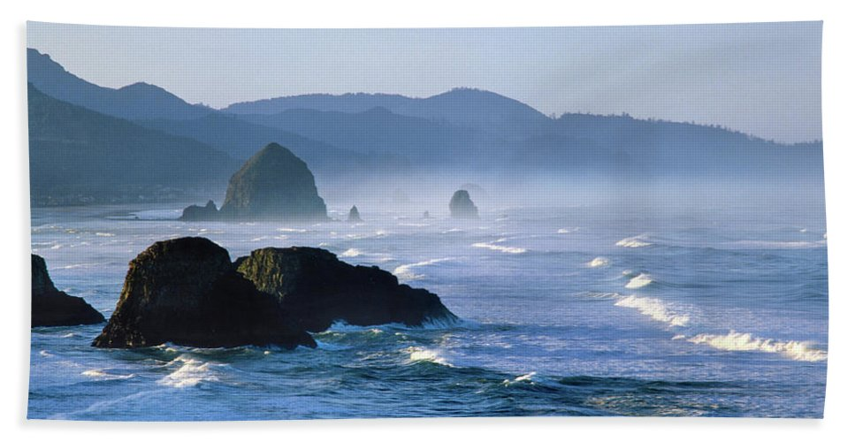 Photography Bath Sheet featuring the photograph Haystack Rocks In Cannon Beach by Panoramic Images