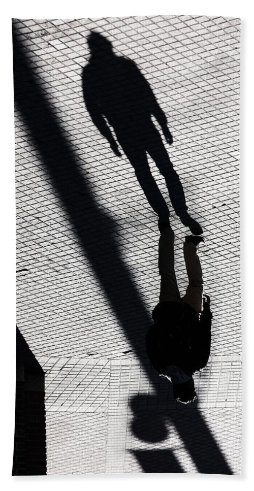 Street Photography Hand Towel featuring the photograph Held By Device by The Artist Project