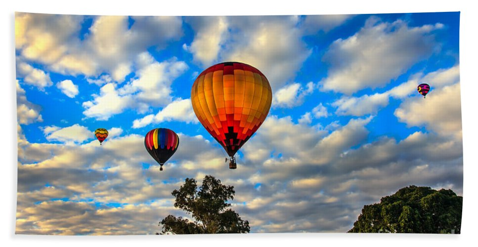 Arizonia Hand Towel featuring the photograph Hot Air Balloons Over Trees by Robert Bales
