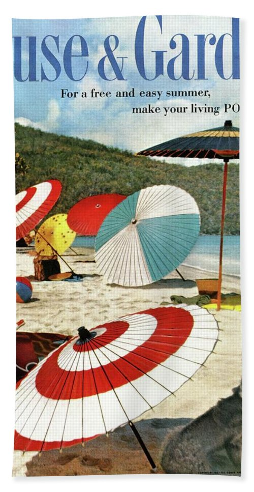 Exterior Bath Towel featuring the photograph House And Garden Featuring Umbrellas On A Beach by Otto Maya & Jess Brown