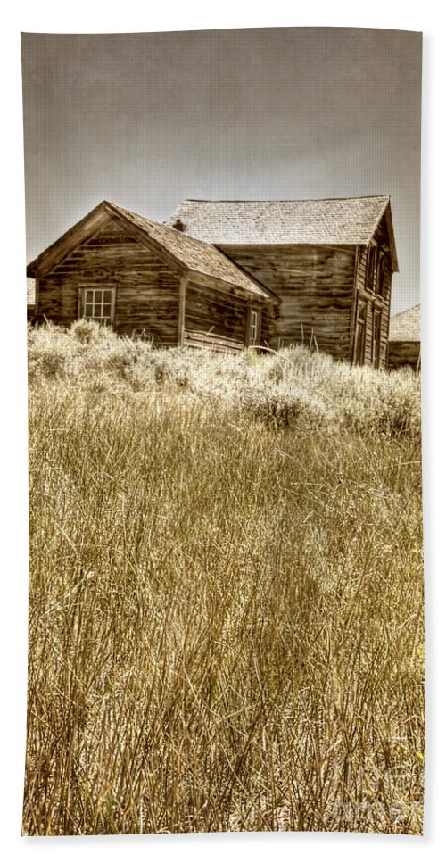 Structure; Wood; Wooden; Country; Countryside; Desert; Deserted; Hill; Worn; Abandoned; Boards; Ruins; Grasses; Hills; House; Home; Sepia; Rural; Vast; Dirt; Window; Sky; Vintage; Antique Hand Towel featuring the photograph House On The Hill by Margie Hurwich
