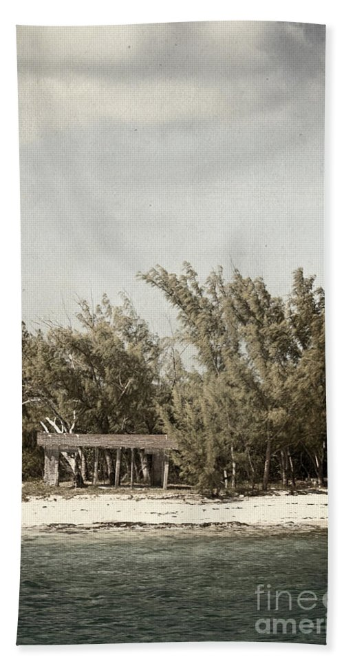 Fort; Garage; Picnic; Area; Beach; Water; Island; Deserted; Tropical; Waterfront; Shore; Coast; Bahamas; Shallow; Blue; Sky; Clouds; Sand; Trees; Building; Wood; Outside; Outdoors; Exterior; Cottage; Tropics; Ocean; Sea; Lake Hand Towel featuring the photograph House On The Water by Margie Hurwich