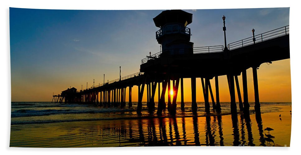 Sunset Bath Sheet featuring the photograph Huntington Beach Pier At Sunset by Jamie Pham
