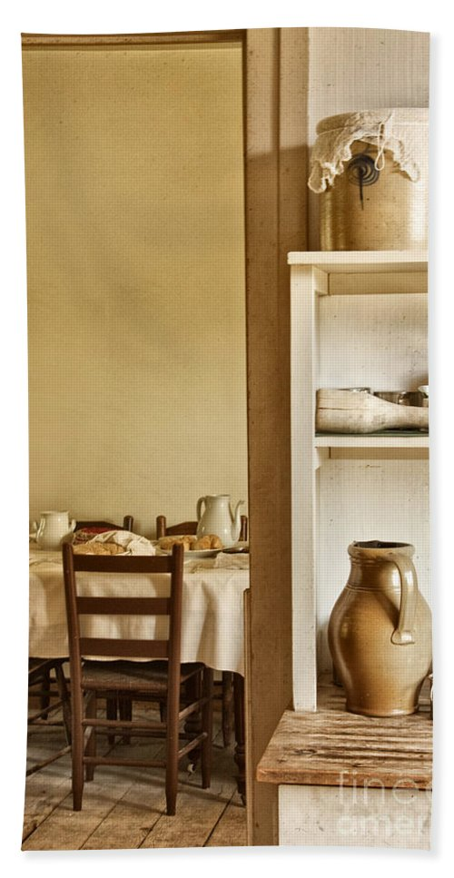 House; Home; Vintage; Kitchen; Dining Room; Utensils; Pots; Pitcher; Shelf; Pantry; Butlers; Table; Chairs; Food; Dinner; Supper; Lunch; Family; Waiting; Door; Doorway; Entry; Wood; Wood Floors; Set Bath Sheet featuring the photograph In The Kitchen by Margie Hurwich