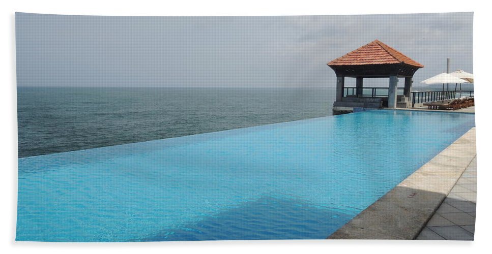 Infinity Pool Hand Towel Featuring The Photograph At Leela Kovalam By Mini Arora