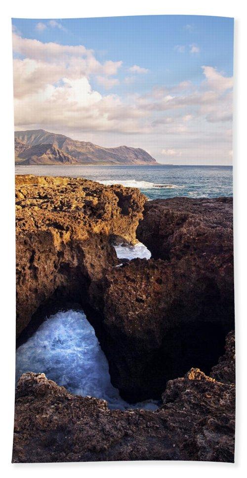 Landscape Bath Sheet featuring the photograph Ka'ena Point Natural Bridge by Marcia Colelli