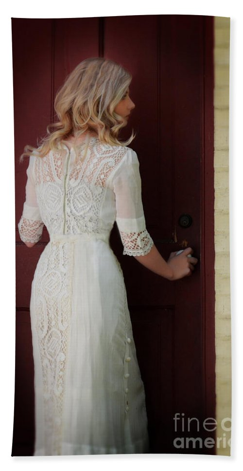Woman Hand Towel featuring the photograph Lady In Edwardian Dress Opening A Door by Jill Battaglia