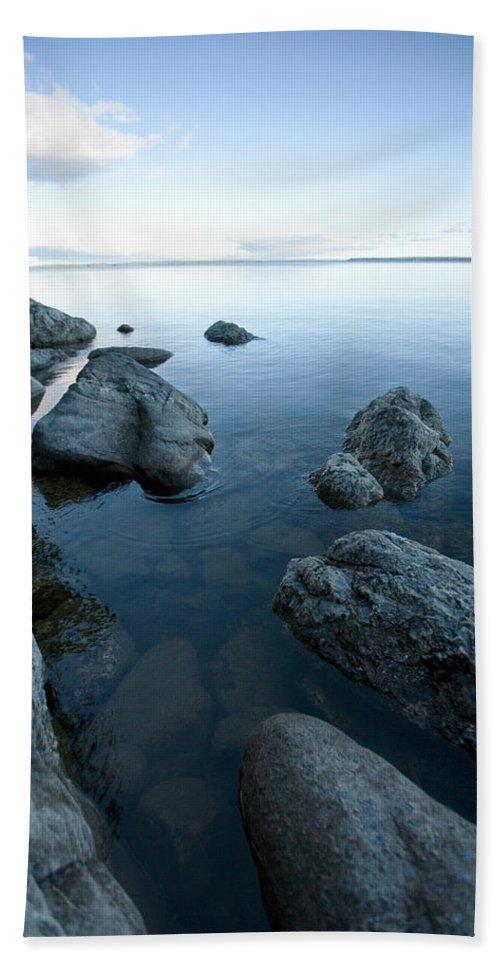Calm Bath Sheet featuring the photograph Landscape Of Rocks Along Shoreline by Woods Wheatcroft