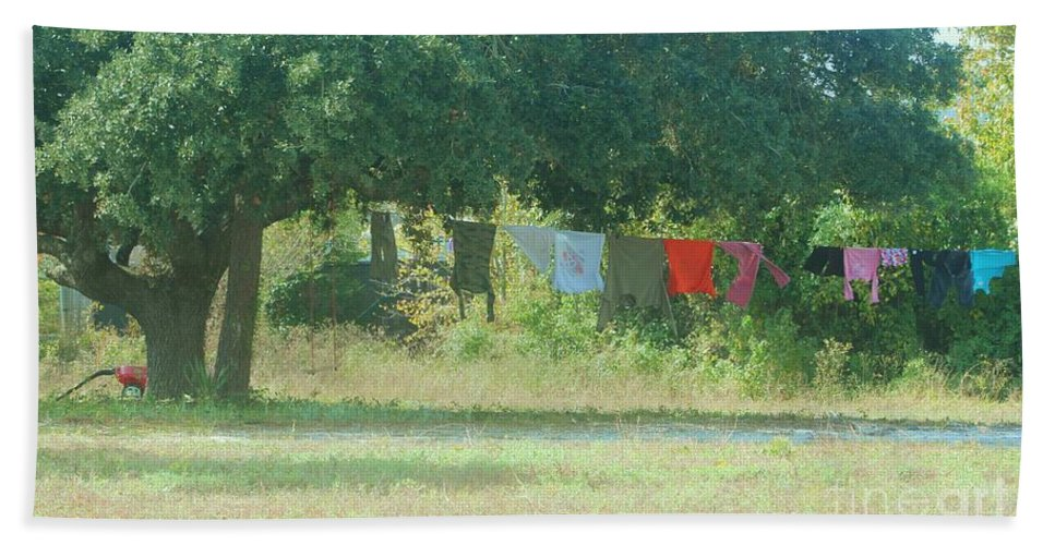 Laundry Hand Towel featuring the photograph Laundry Hanging From The Tree by Michelle Powell