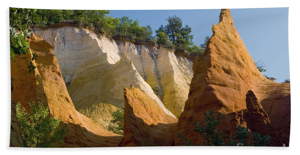 Le Colorado Ochre Rustrel France Colored Clay Landscape Landscapes Tree Trees Plant Plants Light Shadow Shadows Provence Bath Sheet featuring the photograph le Colorado Ochre by Bob Phillips