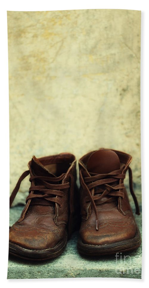 Vertical Hand Towel featuring the photograph Leather Children Boots by Jaroslaw Blaminsky