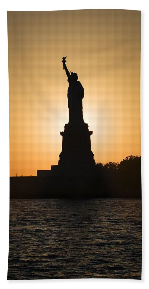 Statue Of Liberty Hand Towel featuring the photograph Liberty Sunset by Dave Bowman