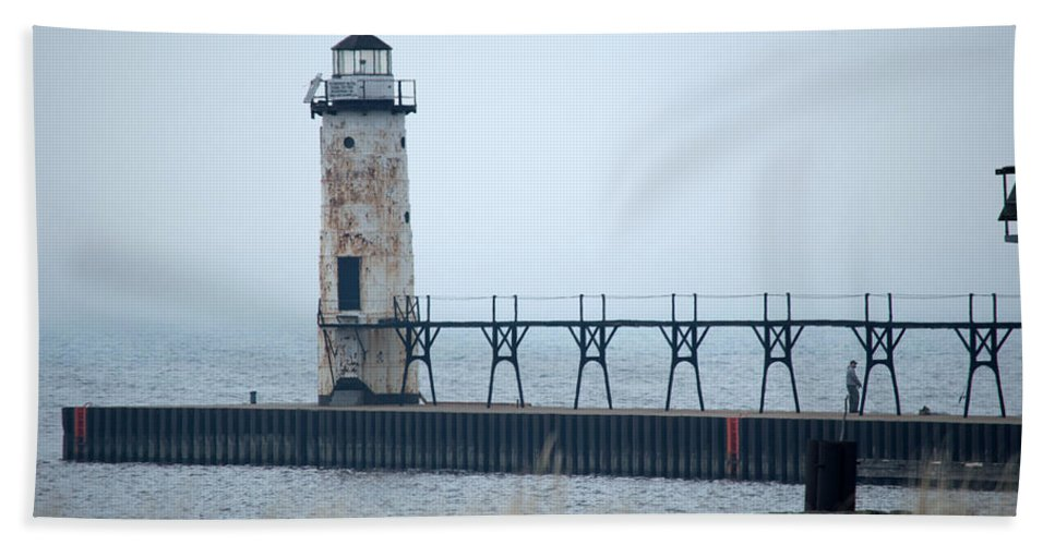Manistee Lighthouse Hand Towel featuring the photograph Lighthouse In Haze by Linda Kerkau
