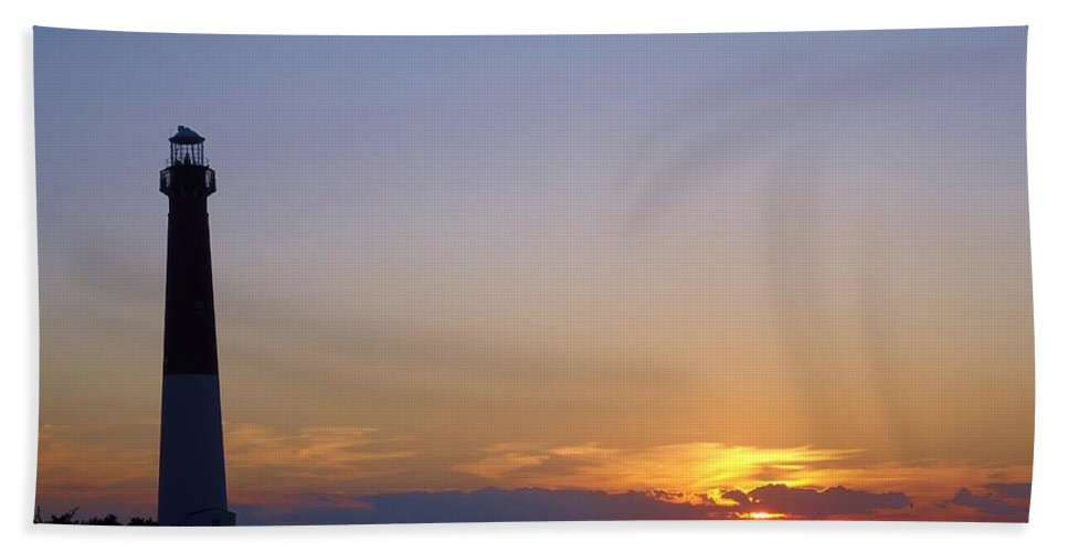 Sunrise Hand Towel featuring the photograph Lighthouse Sunset by Art Dingo