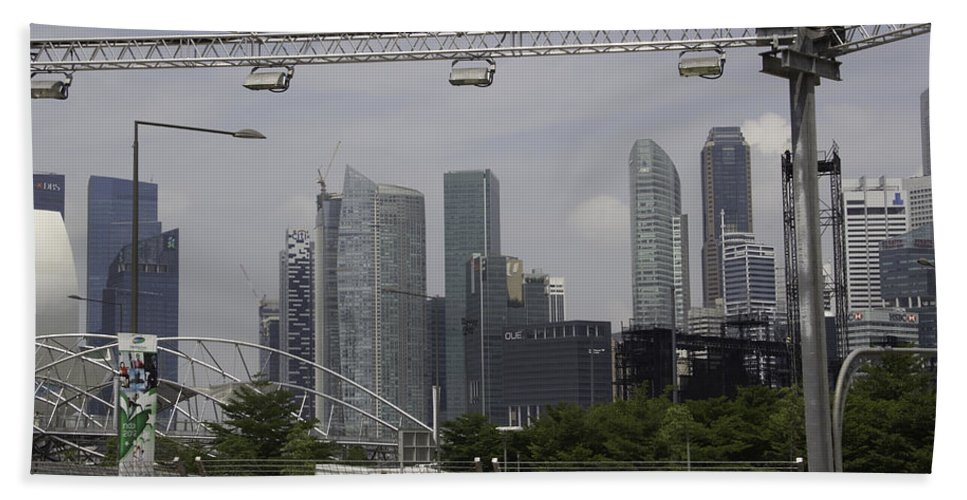 Action Bath Sheet featuring the photograph Lighting Work For The Singapore Formula One And A View Of The Helix Bridge by Ashish Agarwal