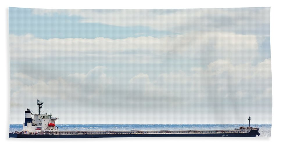 Big Bath Sheet featuring the photograph Loaded Oil Tanker On Ocean Under Stormy Sky Clouds by Stephan Pietzko