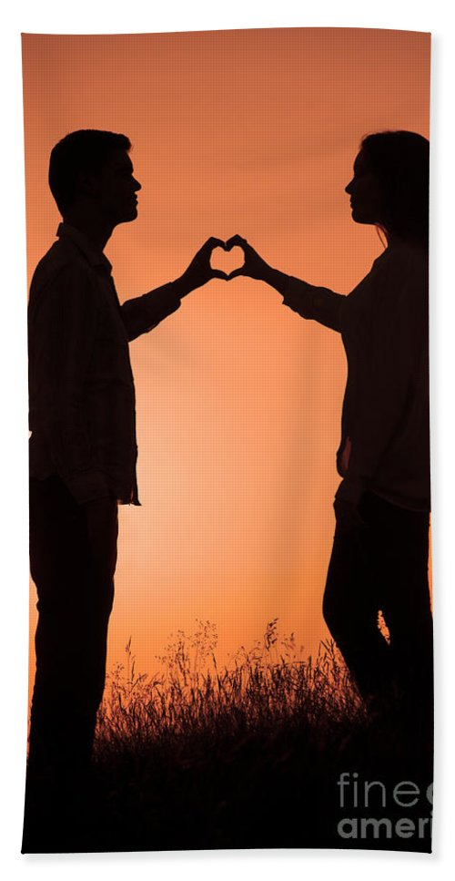 Couple Bath Sheet featuring the photograph Lovers Making A Heart Shape At Sunset by Lee Avison