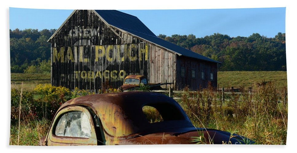 Paul Ward Bath Towel featuring the photograph Mail Pouch Barn And Old Cars by Paul Ward