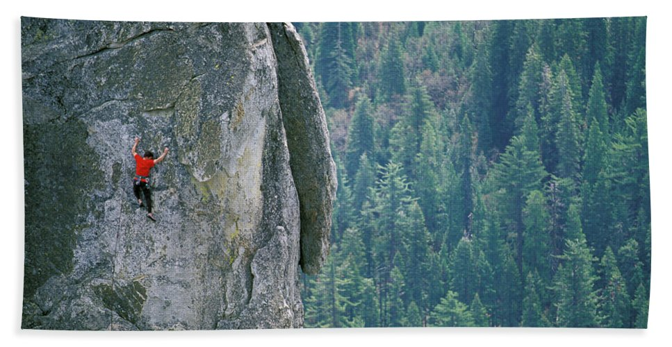 Action Bath Towel featuring the photograph Man Climbing On A Big Granite Spire by Corey Rich