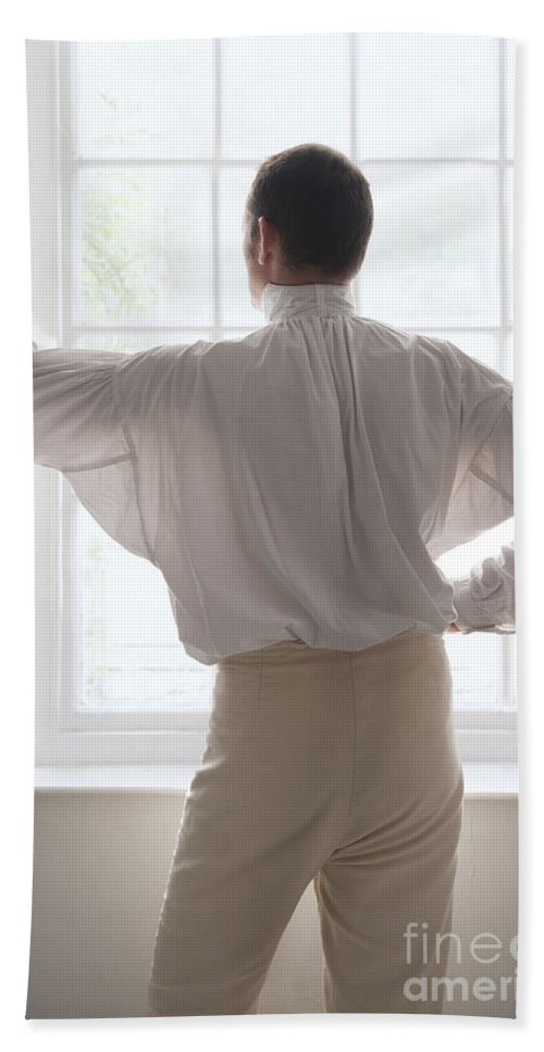 Gentleman Bath Sheet featuring the photograph Man In Historical Shirt At The Window by Lee Avison