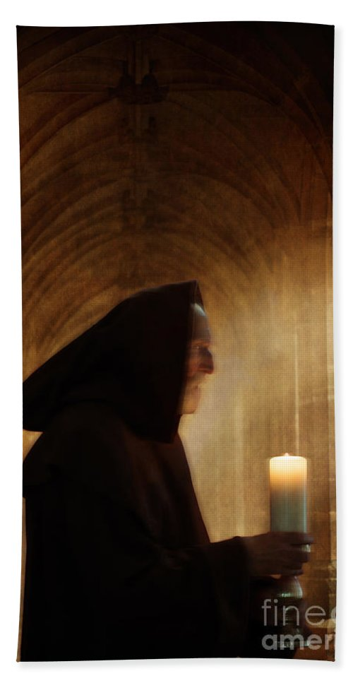 Monk Hand Towel featuring the photograph Monk With Candle In Cathedral by Lee Avison