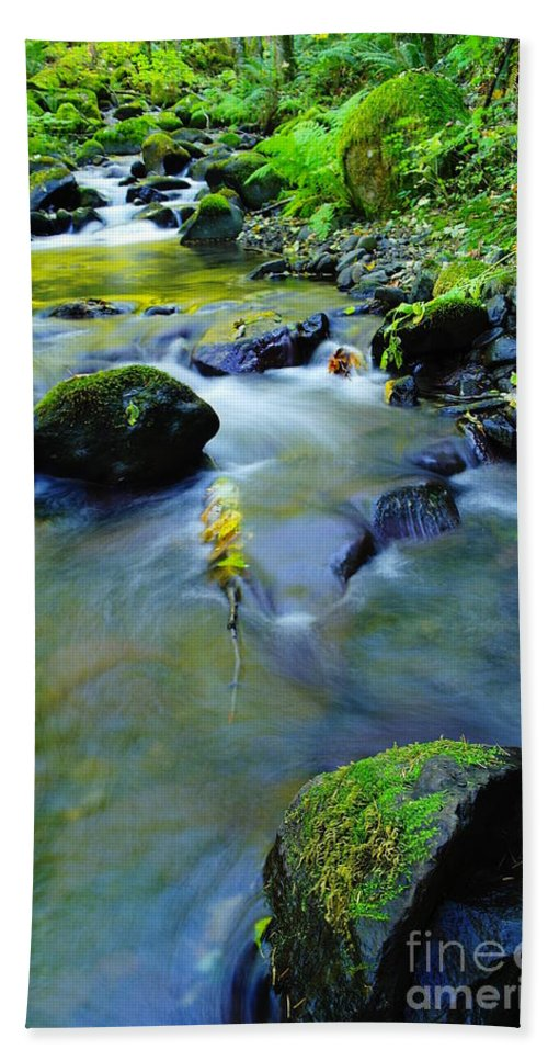 Water Bath Sheet featuring the photograph Mossy Rocks And Moving Water by Jeff Swan