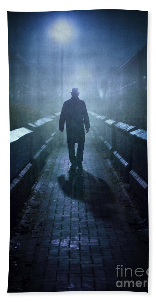 Man Bath Sheet featuring the photograph Mysterious Man In Fog At Night by Lee Avison