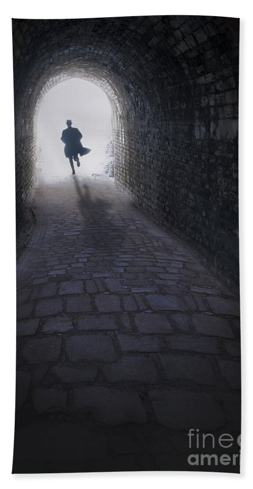 Man Hand Towel featuring the photograph Mysterious Man Running Out Of A Tunnel by Lee Avison