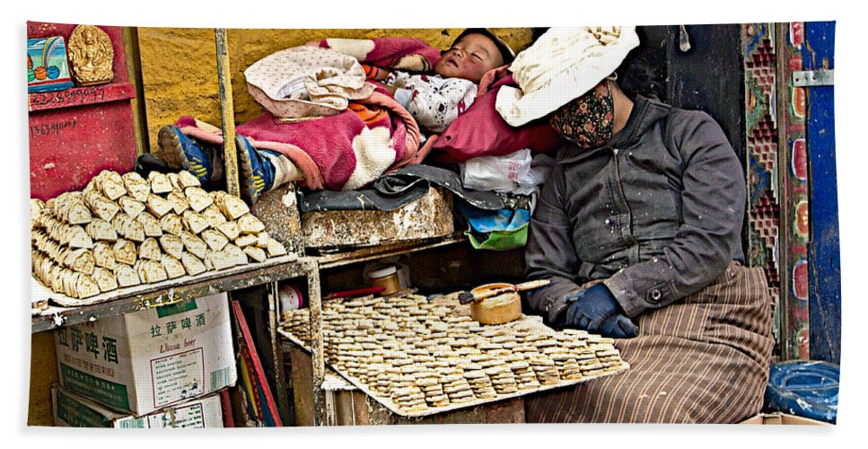 Nap Time For Child And Street Shopkeeper In Lhasa Bath Sheet featuring the photograph Nap Time For Child And Street Shopkeeper In Lhasa-tibet  by Ruth Hager