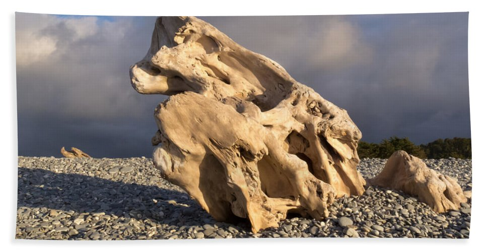 Background Hand Towel featuring the photograph Naturally Sculpted Waterworn Wood On Pebble Beach by Stephan Pietzko