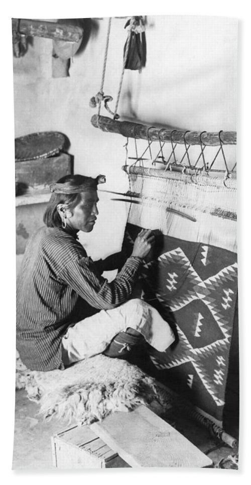 1920 Bath Towel featuring the photograph Navajo Man Weaving A Blanket by Underwood Archives